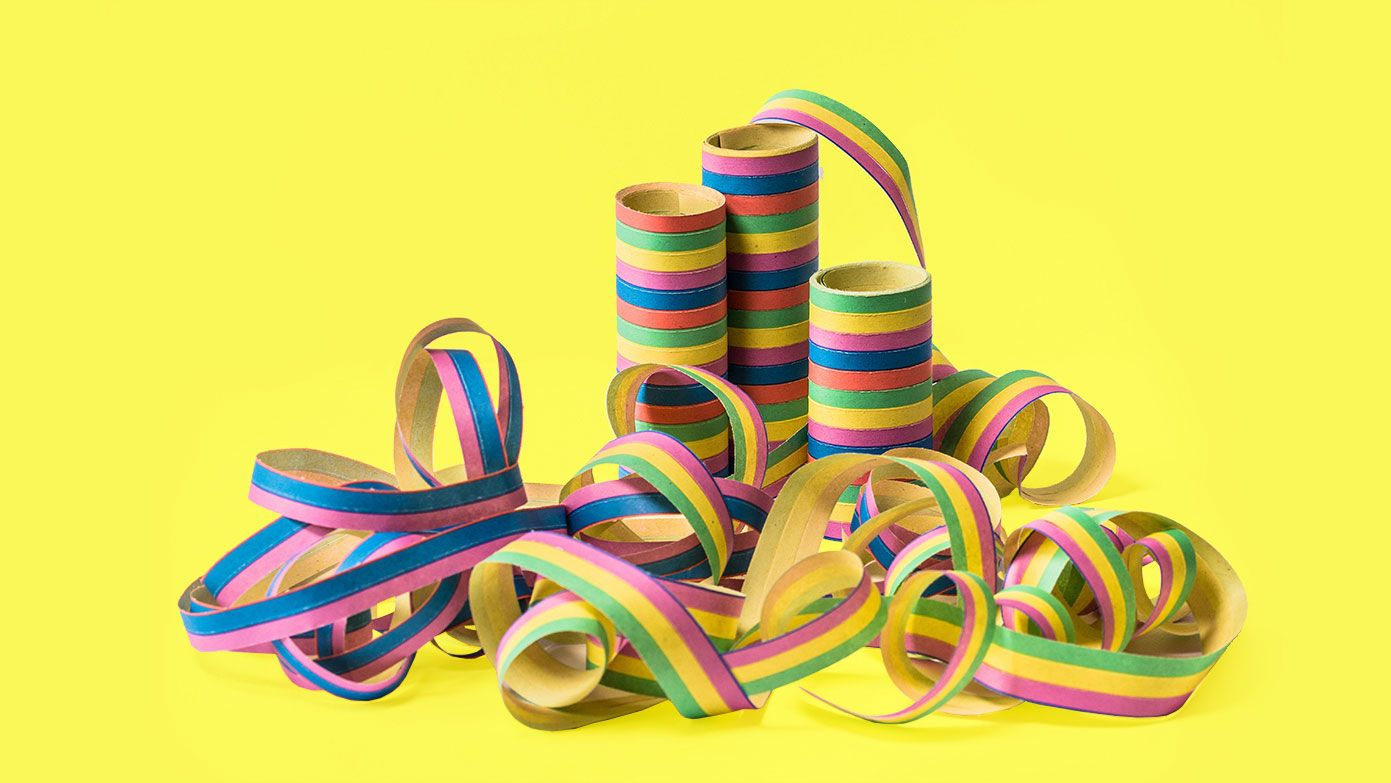 Multi coloured party string on a yellow background